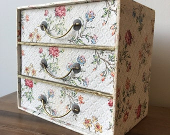 A pretty set of vintage embossed cardbord storage drawers