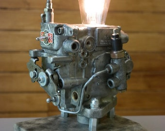 Table lamp made from recycled car parts diesel pump