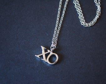 silver tone XO kiss kiss necklace