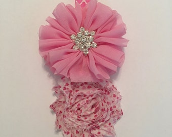 A sweet pink and white headband with rhinestones