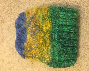 blue, yellow green knit cable hat