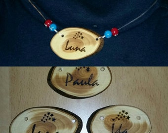 Pendant made from yew with name or characters