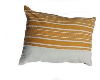 Cushion cover made of vintage fabric with yellow stripes