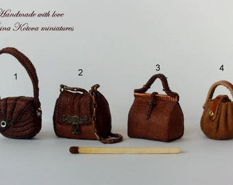 Dollhouse Miniature natural leather Handbag.If you are looking for a unique element to add to your miniatures, this is it!