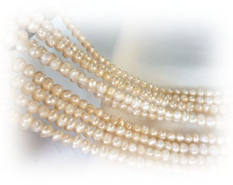 Irregular Ivory River pearls/ PEARLS/ ivory of 6x7x8 mm hole 1 mm strand 65 pearls