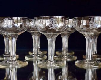 A rare Set of nine Monogrammed Hollow Stem Champagne Glasses c.1880