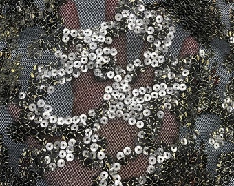 stretch lace sequins on it - 4 way stretch 55 inches width