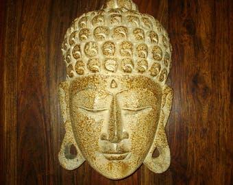 Hand-carved Buddha mask