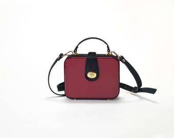 in patent red leather and black leather bag