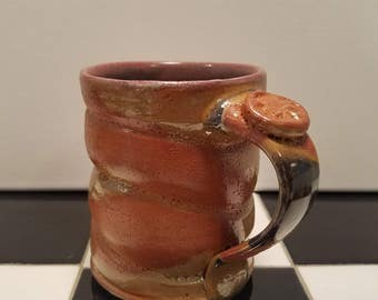 Handmade gold and orange mug, with red and turquoise liner