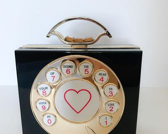 """the vintage """"Call me"""" clutch"""