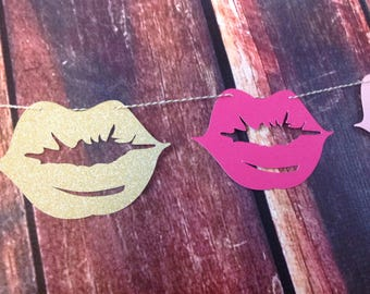 9 ft lips garland shades of pink and gold.