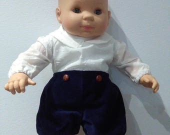 Fine corduroy pants with clip and decorative buttons on the front, elastic back waist, white lining, handmade