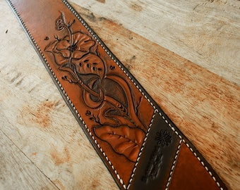 Adjustable leather guitar strap sewn entirely by hand.