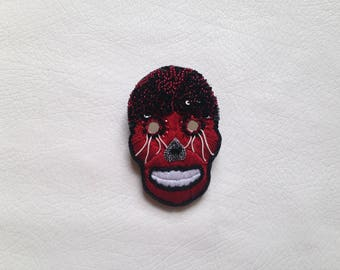 "Embroidered brooch hand ""Alx"""