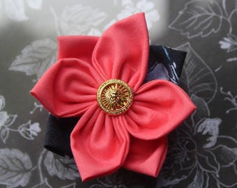 Pink and navy blue fabric flower