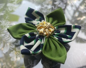 Green, navy blue and white fabric flower