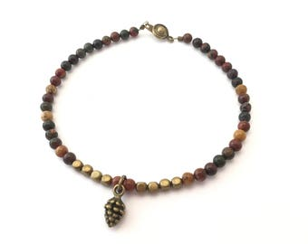 SALE - Red creek jasper beaded bracelet with brass pine cone charm