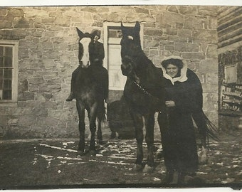 Moody dark two horses woman gothic vernacular black dress shadow equus equine farm rural antique vintage photo