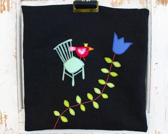 Black linen cushion cover with whimsical applique