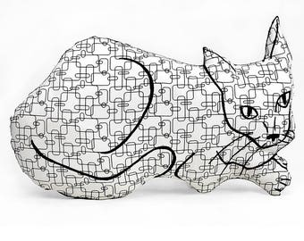 decorative pillow, cat pillow, kitty pillow, kitty shaped, animal pillow, big relaxed cat shaped white and black graphic patterned fabric