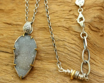Druzy pendant necklace in silver bezel and brass prongs and sterling silver beads on the side oxidized sterling silver chain