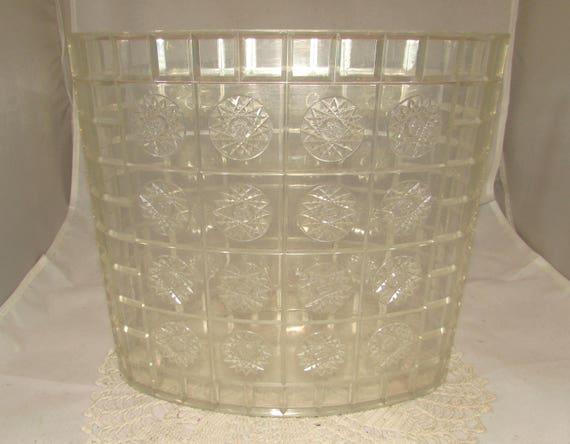 vintage oval shaped lucite or acrylic waste basket or trash