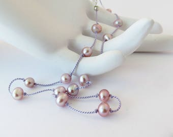 pink pearls on lilac tin cup