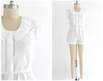 vintage 1980s white semi-sheer ruffle sleeve romper | 80s button up playsuit | vtg romper with pockets | small