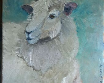 Large sheep face on wooden square