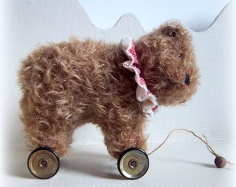 little mohair circus bear on vintage Meccano wheels