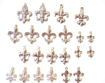 22 or 11 Pairs of a Variety of Small Fleur de Lis Charms Silver and Antique Silver-tone