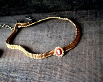 Victorian style vintage 80s gold tone metal, mesh choker necklace with a tiny cameo. Made by Park Line.