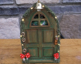 Fairy door with white lights and accessories