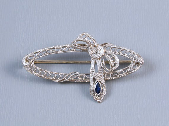 Vintage Art Deco 14K white gold filigree blue sapphire and diamond ribbon bow shaped brooch pin signed Esemco Shiman