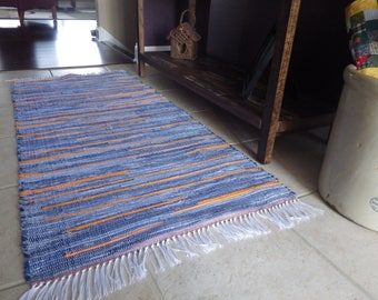 """Hand Woven Orange and Denim Rag Rug 25"""" x 59  Nothing boring about this rug"""