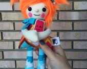 Little Hugs Fleece Dolls.Argyle and Popsicle print plushie. Plush toy holding coordinating mini pillow.Orange faux fur hair. Ginger Rag doll