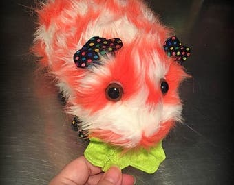 Shortcake the Plush Guinea Pig. Red and White Faux Fur Plushie eating lettuce. Dotted fabric cavy. Lifesize