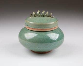Aqua stoneware ceramic lidded jar with telephone cord handle