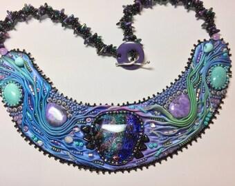 Shibori silk embroidered bib necklace with dichroic glass focal