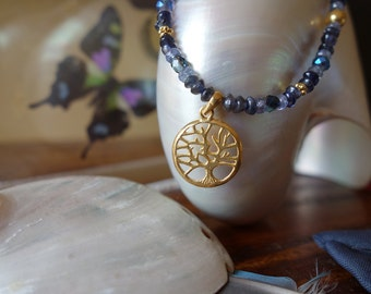 Gold tree pendant with blue iolite and tanzanite beaded necklace