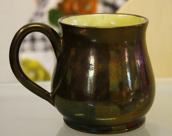 Creigiau pottery copper lustre jug with green finish, welsh pottery