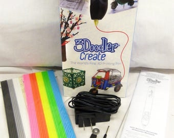 3Doodler Create.  The World's First 3D Printing Pen. Used Once. Manual included. 50 plastic strands in assorted colors also included.