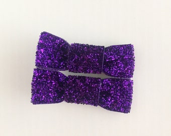 Purple sparkly bow clips