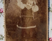 Cabinet Card - A Swinging Girl
