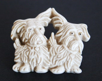 Vintage plastic dog brooch. 2 dog brooch