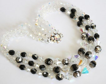 Vintage crystal bead necklace. 3  row necklace. Black and clear beads. Aurora borealis beads.