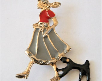 Vintage woman and dog brooch.  Enamel brooch