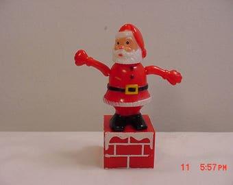 2 Vintage Plastic Christmas Santa Push Button Collapsing Pop Up Toys  17 - 672