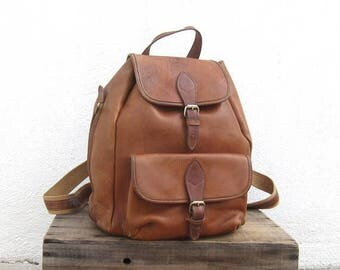 15% Off Out of Town Sale 90s Rucksack Backpack Vintage Distressed Rugged Tan Leather and Knapsack by Timberland